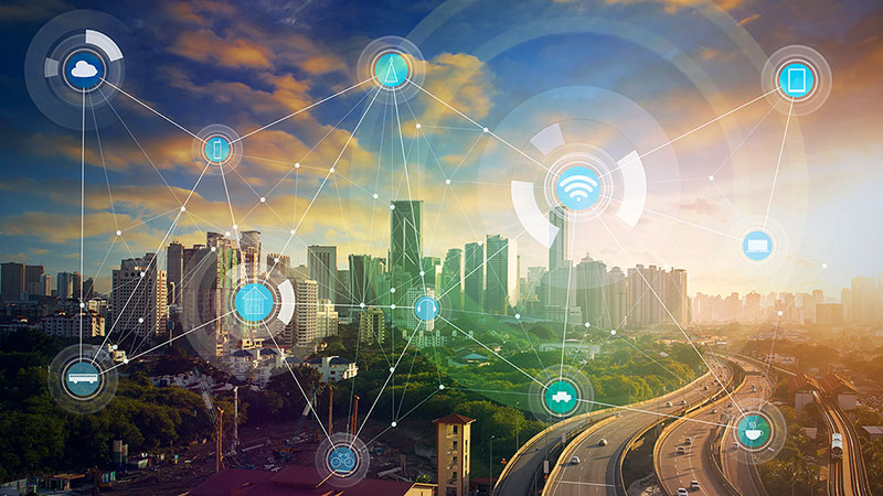 Futuristic cityscape depicting the interconnectivity of many devices.